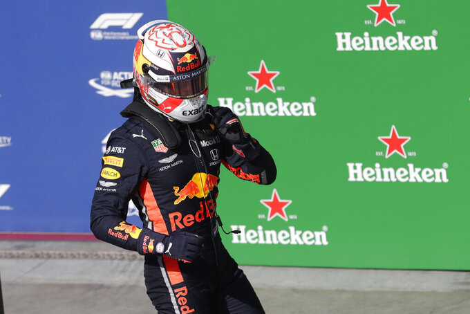 Red Bull driver Max Verstappen, of the Netherlands, celebrates after taking pole position during the qualifying session for the Formula One Brazil Grand Prix at the Interlagos race track in Sao Paulo, Brazil, Saturday, Nov. 16, 2019. (AP Photo/Silvia Izquierdo)