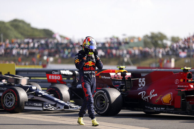 Red Bull driver Sergio Perez of Mexico walks away from his car at the end of the British Formula One Grand Prix, at the Silverstone circuit, in Silverstone, England, Sunday, July 18, 2021. (Lars Baron/Pool photo via AP)