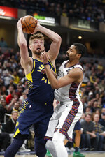 Indiana Pacers forward Domantas Sabonis, left, shoots over Brooklyn Nets guard Spencer Dinwiddie, right, during the first half of an NBA basketball game in Indianapolis, Monday, Feb. 10, 2020. (AP Photo/Michael Conroy)