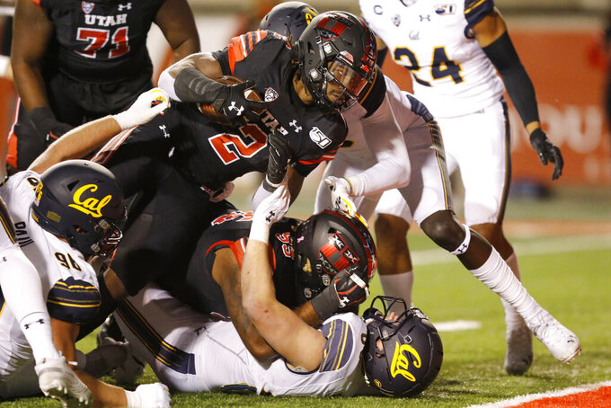 Utah running back Zack Moss (2) scores against California in the first half of an NCAA college football game Saturday, Oct. 26, 2019, in Salt Lake City. (AP Photo/Rick Bowmer)