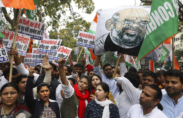 Congress party workers shout slogans against Indian Home Minister Amit Shah during a protest against last week's deadly communal riots in New Delhi, India, Monday, March 2, 2020. (AP Photo/Manish Swarup)