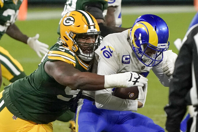 Los Angeles Rams quarterback Jared Goff (16) is sacked by Green Bay Packers' Kenny Clark during the second half of an NFL divisional playoff football game Saturday, Jan. 16, 2021, in Green Bay, Wis. (AP Photo/Morry Gash)