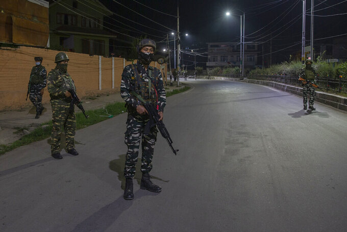 Indian paramilitary soldiers stand guard on the road leading towards the house of top separatist leader Syed Ali Geelani in Srinagar, Indian controlled Kashmir, Thursday, Sept. 2, 2021. Geelani, a top separatist leader and one of the severest critics of Indian rule in the disputed Himalayan region of Kashmir, died late Wednesday. He was 92. Authorities announced a communication blockade and the restriction of public movement, a common tactic employed by Indian officials in anticipation of anti-India protests. (AP Photo/ Dar Yasin)