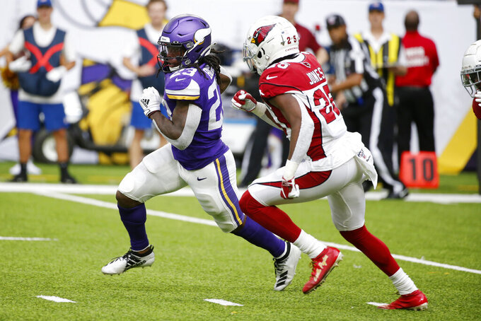 Minnesota Vikings running back Mike Boone (23) runs from Arizona Cardinals cornerback Chris Jones, right, during the second half of an NFL preseason football game, Saturday, Aug. 24, 2019, in Minneapolis. (AP Photo/Bruce Kluckhohn)