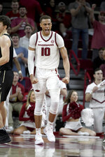 Arkansas forward Daniel Gafford (10) celebrates after a big play against Vanderbilt during the second half of an NCAA college basketball game, Tuesday, Feb. 5, 2019 in Fayetteville, Ark. (AP Photo/Michael Woods)