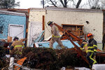 Rescue Workers search through damage after a tornado touchdown in Wetumpka, Ala., on Saturday, Jan. 19, 2019. The mayor of Wetumpka in central Alabama says a possible tornado has caused significant damage to the city's downtown, with several buildings on the ground after an intense storm passed through the area. (Mickey Welsh/The Montgomery Advertiser via AP)
