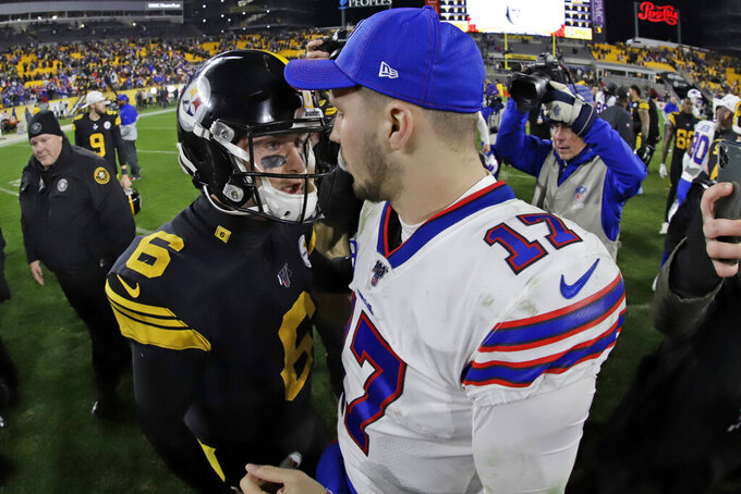 Buffalo Bills quarterback Josh Allen (17) visits with Pittsburgh Steelers quarterback Devlin Hodges (6) following an NFL football game in Pittsburgh, Sunday, Dec. 15, 2019. The Bills won 17-10. (AP Photo/Gene J. Puskar)