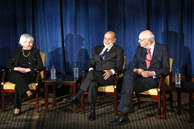 FILE - In this April 7, 2016, file photo Federal Reserve chair Janet Yellen, left, and former Federal Reserve chairs Ben Bernanke, center, and Paul Volcker, right, react as they listen to former Fed Chair Alan Greenspan appearing via video conference, during a panel discussion in New York. Volcker, the former Federal Reserve chairman died on Sunday, Dec. 8, 2019, according to his office, He was 92. (AP Photo/Kathy Willens, File)