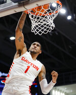 Dayton's Obi Toppin dunks during the first half of an NCAA college basketball game against Drake, Saturday, Dec. 14, 2019, in Dayton, Ohio. (AP Photo/John Minchillo)
