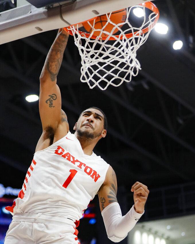 Dayton's Obi Toppin dunks during the first half of an NCAA college basketball game against Drake, Saturday, Dec. 14, 2019, in Dayton, Ohio. (AP Photo/John Minchillo)