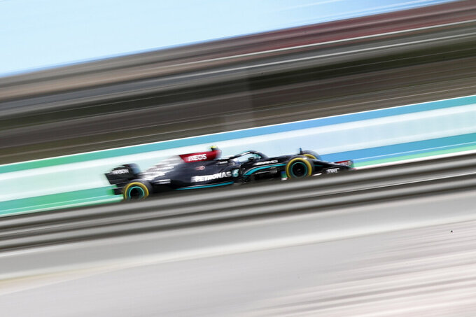 Mercedes driver Valtteri Bottas of Finland steers his car during the Spanish Formula One Grand Prix at the Barcelona Catalunya racetrack in Montmelo, just outside Barcelona, Spain, Sunday, May 9, 2021. (AP Photo/Joan Monfort)