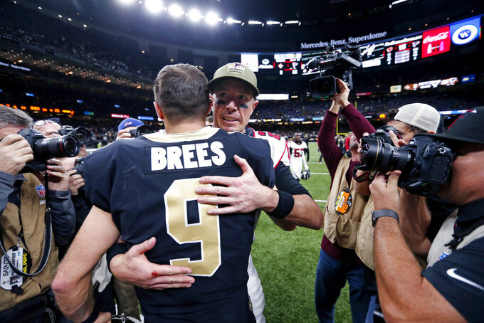New Orleans Saints quarterback Drew Brees (9) hugs Atlanta Falcons quarterback Matt Ryan after an NFL football game in New Orleans, Sunday, Nov. 10, 2019. The Falcons won 26-9.(AP Photo/Butch Dill)