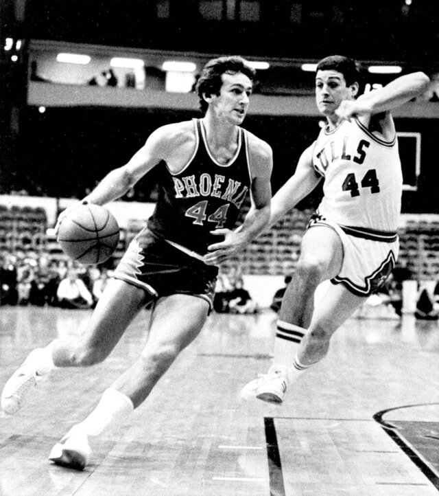 FILE - In this Jan. 12, 1976 file photo, Phoenix Suns' Paul Westphal (44) drives toward the basket as Chicago Bulls' Tom Kropp (44) makes an effort to block his advance during NBA basketball game in Chicago.  Westphal, the Hall of Fame basketball player has died. The Phoenix Suns confirmed his death Saturday, Jan. 2, 2021.  (AP Photo/Fred Jewell)