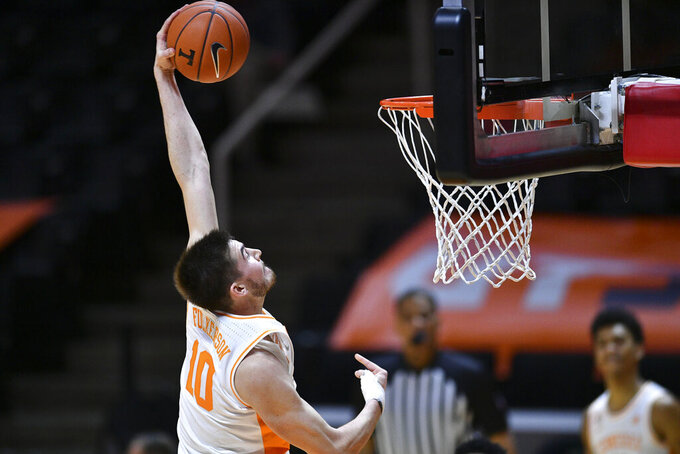 Tennessee's John Fulkerson scores against South Carolina-Upstate during an NCAA college basketball game Wednesday, Dec. 23, 2020, in Knoxville, Tenn. (Saul Young/Knoxville News Sentinel via AP, Pool)
