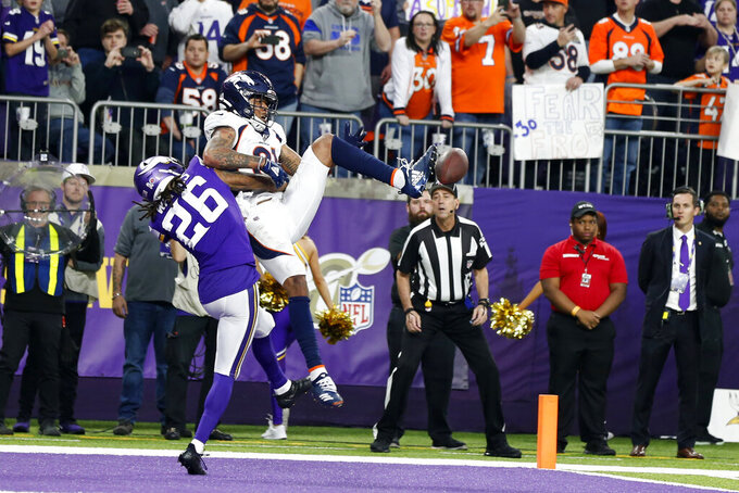 Minnesota Vikings cornerback Trae Waynes (26) breaks up a pass intended for Denver Broncos wide receiver Tim Patrick (81) in the end zone during the second half of an NFL football game, Sunday, Nov. 17, 2019, in Minneapolis. The Vikings won 27-23. (AP Photo/Bruce Kluckhohn)