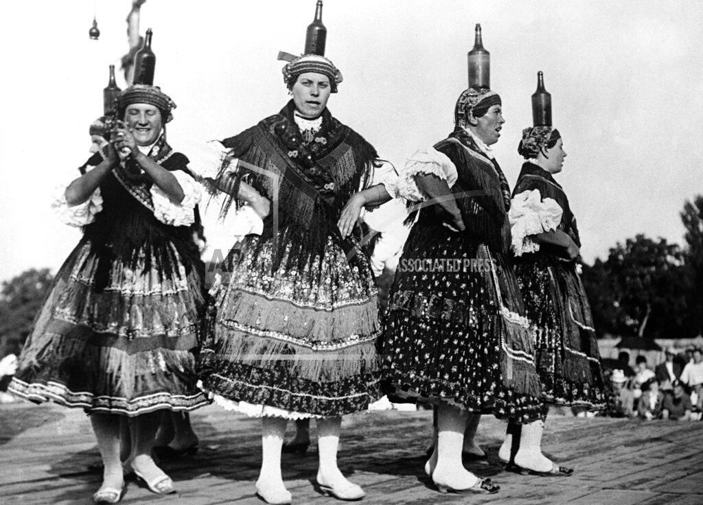 Watchf AP I   HUN APHSL50803 Hungary Women Dancing With Bottles On Head