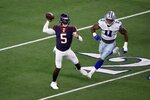 Houston Texans quarterback Tyrod Taylor (5) throws a pass in the first half of a preseason NFL football game under pressure from Dallas Cowboys linebacker Micah Parsons (11) in Arlington, Texas, Saturday, Aug. 21, 2021. (AP Photo/Roger Steinman)