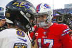 FILE - Buffalo Bills quarterback Josh Allen (17) talks with Baltimore Ravens quarterback Lamar Jackson (8) following a 24-17 Ravens win in an NFL football game in Orchard Park, N.Y., in this Sunday, Dec. 8, 2019, file photo. Buffalo's Josh Allen and Baltimore's Lamar Jackson become the first quarterbacks of the five-member 2018 first-round draft class set to meet in the playoffs as the Bills prepare to face the Ravens in the AFC divisional round on Saturday night, Jan. 16, 2021. (AP Photo/John Munson, File)