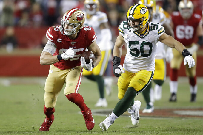 San Francisco 49ers tight end George Kittle, left, runs against Green Bay Packers inside linebacker Blake Martinez (50) during the second half of an NFL football game in Santa Clara, Calif., Sunday, Nov. 24, 2019. (AP Photo/Ben Margot)