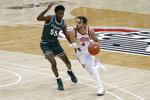 Ohio State's Duane Washington, right, brings the ball up court as Cleveland State's D'Moi Hodge defends during the second half of an NCAA college basketball game Sunday, Dec. 13, 2020, in Columbus, Ohio.  (AP Photo/Jay LaPrete)