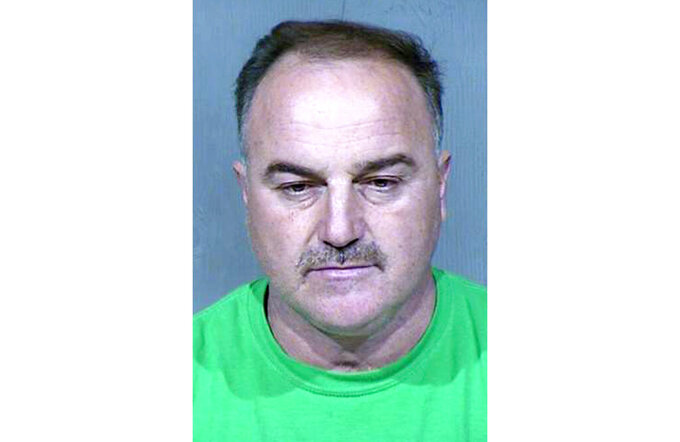 FILE - This undated booking photo provided by the Maricopa County Sheriff's Office shows Ali Yousif Ahmed Al-Nouri, who was arrested in January 2020 in Arizona as part of an extradition request made by the Iraqi government and has been accused of participating in the 2006 killing of two police officers in Iraq. A judge in Phoenix will hold a hearing on Thursday, July 15, 2021, over whether to sign off on a request to extradite Ahmed to Iraq. Ahmed has denied involvement in the killings. (Maricopa County Sheriff's Office via AP)