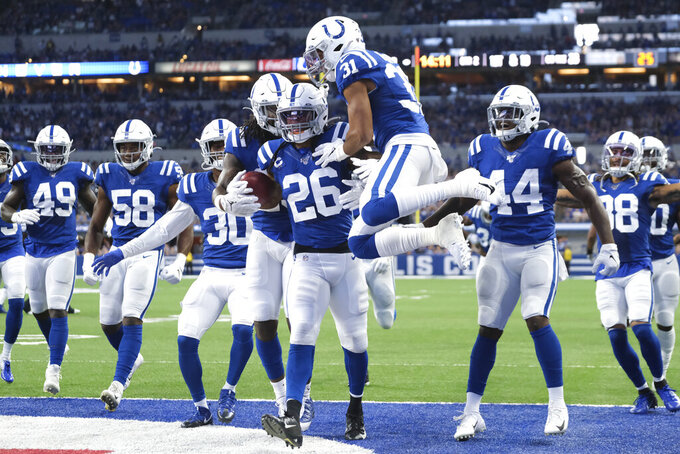 Indianapolis Colts strong safety Clayton Geathers (26) celebrates with cornerback Quincy Wilson (31) after Geathers made in interception during the first half of an NFL football game against the Atlanta Falcons, Sunday, Sept. 22, 2019, in Indianapolis. (AP Photo/AJ Mast)