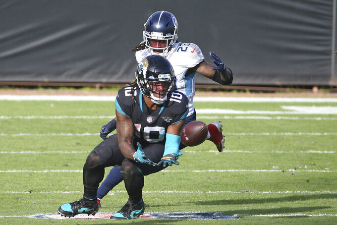 Jacksonville Jaguars wide receiver Laviska Shenault Jr. (10) makes a reception in front of Tennessee Titans cornerback Tye Smith during the second half of an NFL football game, Sunday, Dec. 13, 2020, in Jacksonville, Fla. (AP Photo/Stephen B. Morton)