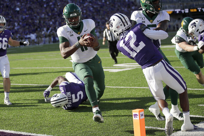 Baylor quarterback Gerry Bohanon (11) scores a touchdown past Kansas State linebacker Da'Quan Patton (5) and defensive back AJ Parker (12) during the second half of an NCAA college football game in Manhattan, Kan., Saturday, Oct. 5, 2019. (AP Photo/Orlin Wagner)