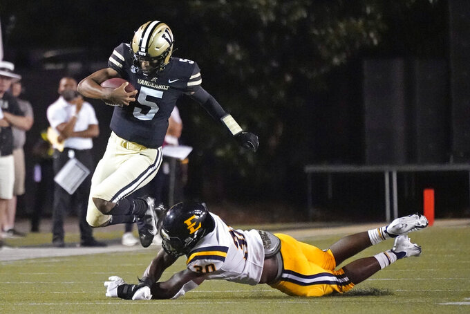 Vanderbilt quarterback Mike Wright (5) is tripped up by East Tennessee State linebacker Donovan Manuel (30) in the first half of an NCAA college football game Saturday, Sept. 4, 2021, in Nashville, Tenn. (AP Photo/Mark Humphrey)