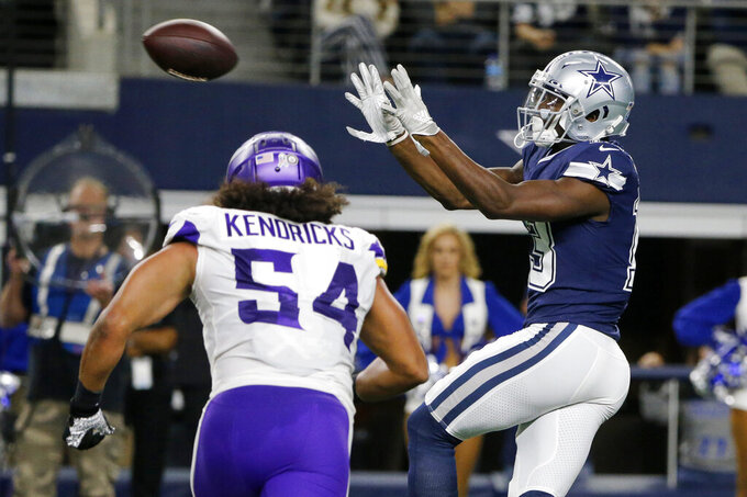 Minnesota Vikings middle linebacker Eric Kendricks (54) defends as Dallas Cowboys wide receiver Michael Gallup (13) catches a pass before running it to the end zone for a touchdown during the first half of an NFL football game in Arlington, Texas, Sunday, Nov. 10, 2019. (AP Photo/Michael Ainsworth)