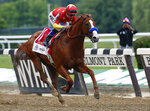 FILE - In this June 9, 2018, file photo, Justify,  jockey Mike Smith up, crosses the finish line to win the 150th running of the Belmont Stakes horse race and the Triple Crown at Belmont Park in Elmont, N.Y. The Belmont Stakes will be run June 20, 2020, without fans and serve as the opening leg of horse racing's Triple Crown for the first time in the sport's history. The New York Racing Association on Tuesday, May 19, 2020, unveiled the rescheduled date for the Belmont, which will also be contested at a shorter distance than usual. This is the first time the Belmont will lead off the Triple Crown ahead of the Kentucky Derby and Preakness.(AP Photo/Peter Morgan, File)