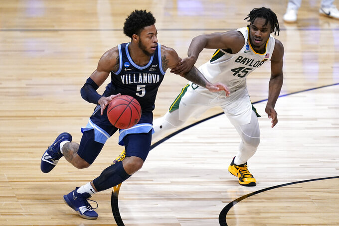 Villanova guard Justin Moore (5) drives on Baylor guard Davion Mitchell (45) in the second half of a Sweet 16 game in the NCAA men's college basketball tournament at Hinkle Fieldhouse in Indianapolis, Saturday, March 27, 2021. (AP Photo/Michael Conroy)