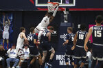 Saint Mary's forward Malik Fitts (24) dunks against Utah State during the second half of an NCAA college basketball game in Moraga, Calif., Friday, Nov. 29, 2019. (AP Photo/Jed Jacobsohn)