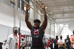 Georgia Bulldogs linebacker Azeez Ojulari (21) attempts a vertical jump during the pro day event, Wednesday , March 17, 2021 in Athen, Ga. (Alika Jenner via AP)
