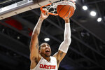 Dayton's Obi Toppin dunks during the first half of an NCAA college basketball game against Houston Baptist, Tuesday, Dec. 3, 2019, in Dayton, Ohio. (AP Photo/John Minchillo)