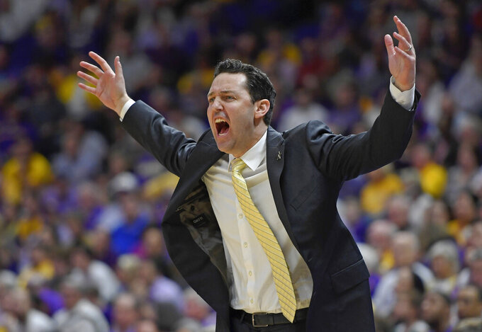 Vanderbilt coach Bryce Drew reacts to a call on one of his players in the first half of an NCAA college basketball game, Saturday, March 9, 2019, in Baton Rouge, La. (AP Photo/Bill Feig)