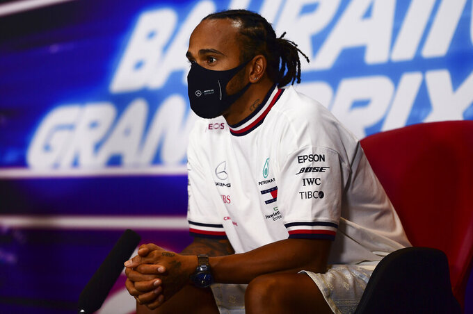 Mercedes driver Lewis Hamilton of Britain participates in a media conference prior to the Bahrain Formula One Grand Prix at the International Circuit in Sakhir, Bahrain, Thursday, Nov. 26, 2020. The Bahrain Formula One Grand Prix will take place on Sunday. (Mario Renzi, Pool via AP)