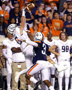 Old Dominion wide receiver Jake Herslow (83) makes a catch over Virginia cornerback Bryce Hall (34) during the first quarter of an NCAA college football game in Charlottesville, Va., Saturday, Sept. 21, 2019. (AP Photo/Andrew Shurtleff)