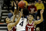 Stanford forwards Oscar da Silva (13) and Spencer Jones (14) try to block a shot by Butler guard Khalif Battle (4) during the first half of an NCAA college basketball game Tuesday, Nov. 26, 2019, in Kansas City, Mo. (AP Photo/Charlie Riedel)