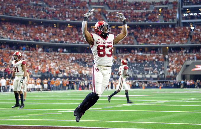 Oklahoma wide receiver Nick Basquine (83) celebrates after his team scored a touchdown at the end of the first half of the Big 12 Conference championship NCAA college football game against Texas on Saturday, Dec. 1, 2018, in Arlington, Texas. (AP Photo/Jeffrey McWhorter)