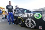 FILE - In this June 10, 2020, file photo, driver Bubba Wallace waits for the start of a NASCAR Cup Series auto race in Martinsville, Va. Bubba Wallace now counts Spike Lee and Demi Lovato – his admitted celebrity crush – as those loudly in his corner since he's become the leader of NASCAR's push for change. (AP Photo/Steve Helber, File)