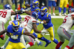Los Angeles Rams defensive end Aaron Donald, center, works against the New York Giants during the first half of an NFL football game Sunday, Oct. 4, 2020, in Inglewood, Calif. (AP Photo/Ashley Landis)