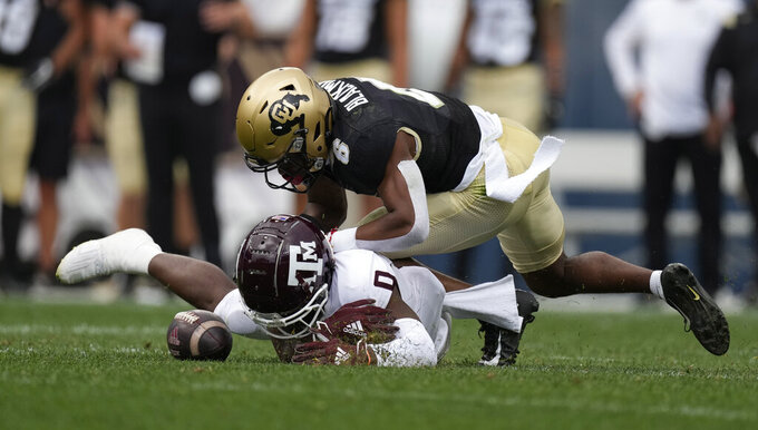 Texas A&M wide receiver Ainias Smith, bottom, tries to catch a pass as Colorado cornerback Mekhi Blackmon defends in the first half of an NCAA college football game Saturday, Sept. 11, 2021, in Denver. (AP Photo/David Zalubowski)