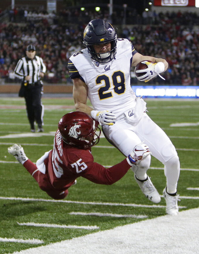 Washington State safety Skyler Thomas (25) pushes California running back Patrick Laird (28) out of bounds during the first half of an NCAA college football game in Pullman, Wash., Saturday, Nov. 3, 2018. (AP Photo/Young Kwak)
