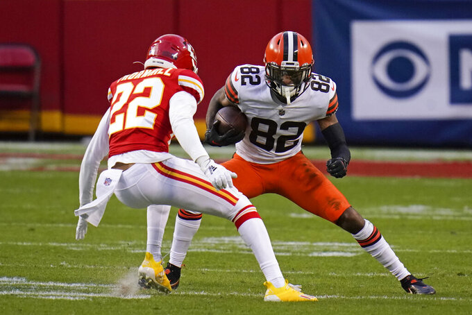 Cleveland Browns wide receiver Rashard Higgins (82) runs from Kansas City Chiefs safety Juan Thornhill (22) after catching a pass during the second half of an NFL divisional round football game, Sunday, Jan. 17, 2021, in Kansas City. (AP Photo/Jeff Roberson)