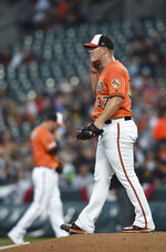 Baltimore Orioles Dylan Bundy reacts after giving up a home run to the New York Yankees during the first inning of a baseball game Saturday, April 6, 2019, in Baltimore. (AP Photo/Gail Burton)