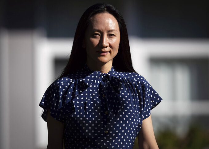 Meng Wanzhou, chief financial officer of Huawei, leaves home to attend her extradition hearing at B.C. Supreme Court in Vancouver, British Columbia, Wednesday, Aug. 11, 2021. (Darryl Dyck/The Canadian Press via AP)