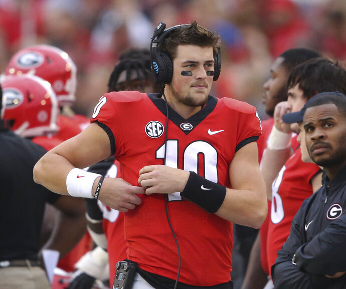FILE - In this Nov. 18, 2017, file photo, Georgia quarterback Jacob Eason (10) stands along the sideline during the first half of the team's NCAA college football game against Kentucky in Athens, Ga.  Eason said Friday, Jan, 12, he is leaving Georgia, an expected decision after he lost his starting job to freshman Jake Fromm. Eason made the announcement on his Twitter account.