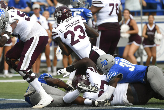 Mississippi State running back Dillon Johnson (23) scores a touchdown during the first half of an NCAA college football game against Memphis, Saturday, Sept. 18, 2021, in Memphis, Tenn. (AP Photo/John Amis)
