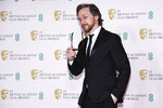Actor James McAvoy poses for photographers upon arrival at the Bafta Film Awards, in central London, Sunday, April 11 2021. (AP Photo/Alberto Pezzali)